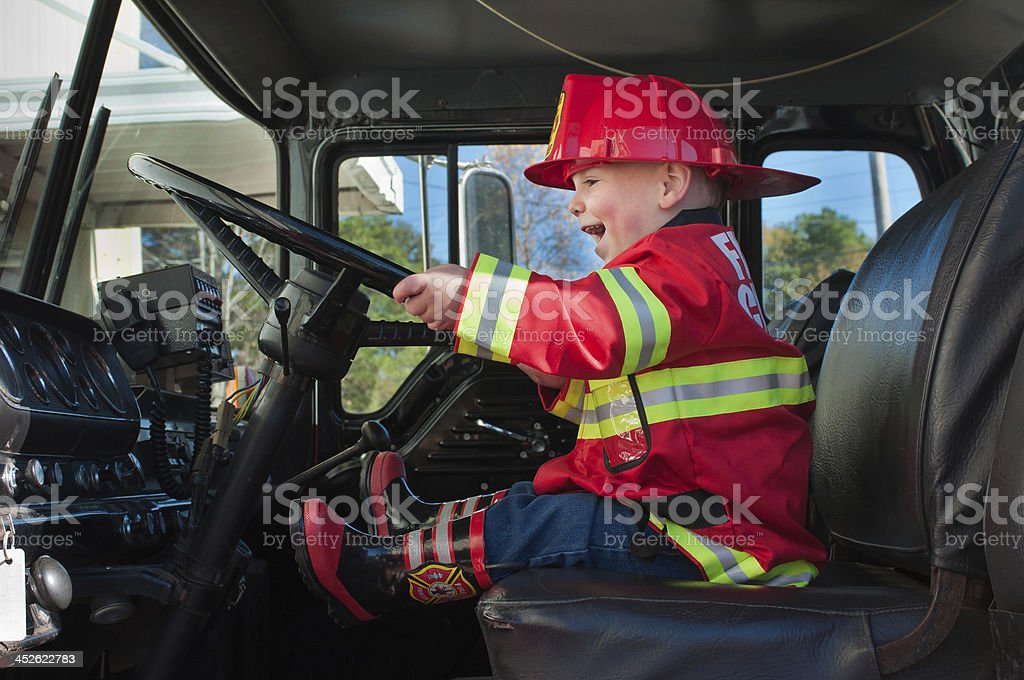 Boy in Fire Truck stock photo