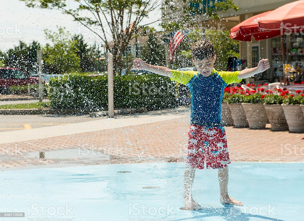Boy in Fountain stock photo