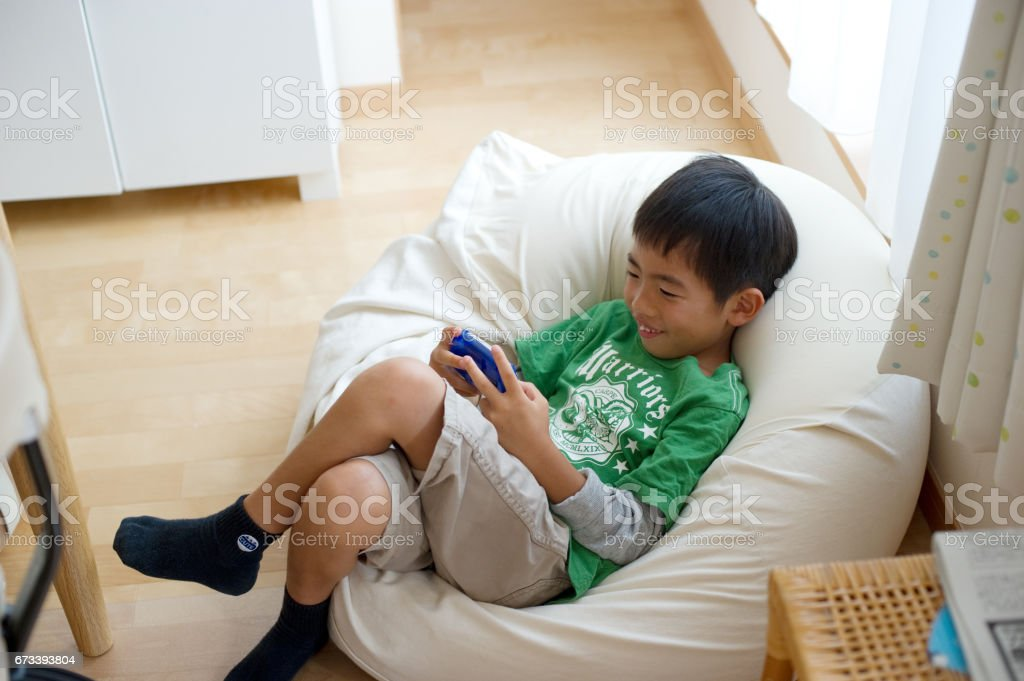 Boy in game stock photo
