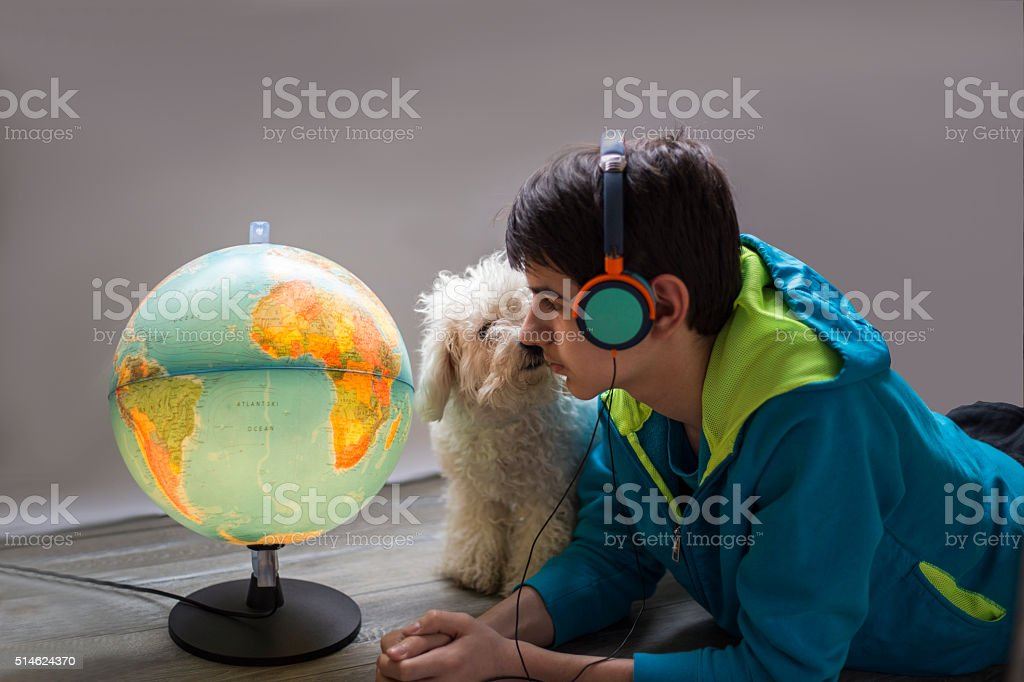 boy in headphones listening to music with a dog stock photo