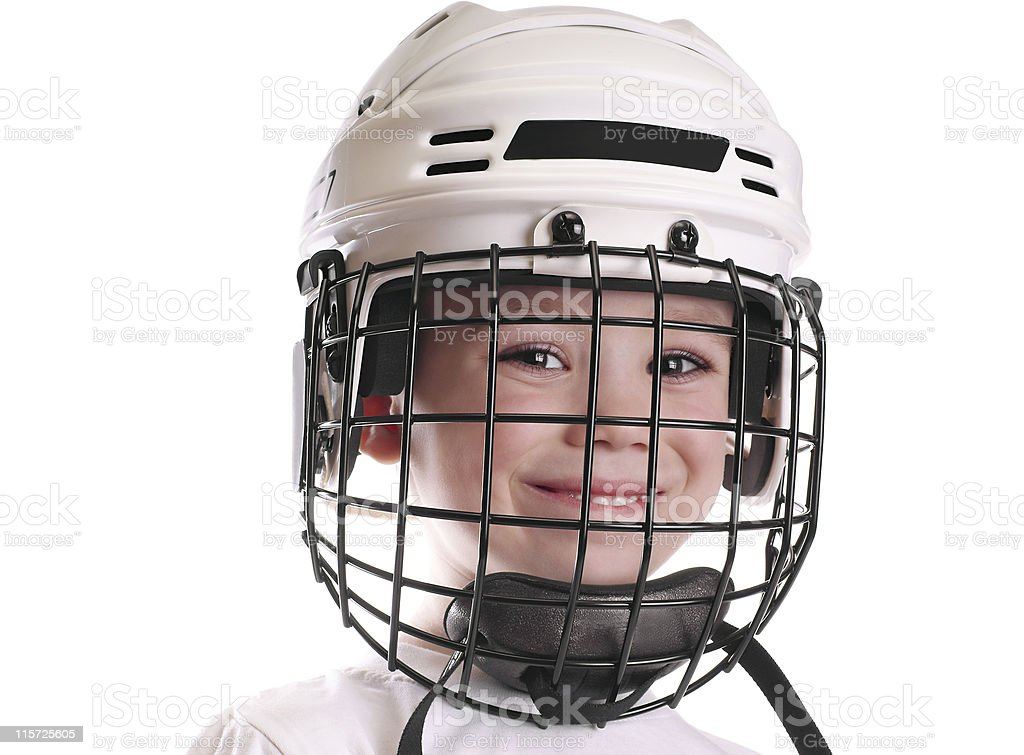 Boy in hockey helmet stock photo