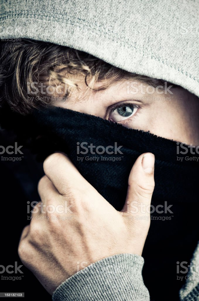 Boy in hoodie hiding his face royalty-free stock photo