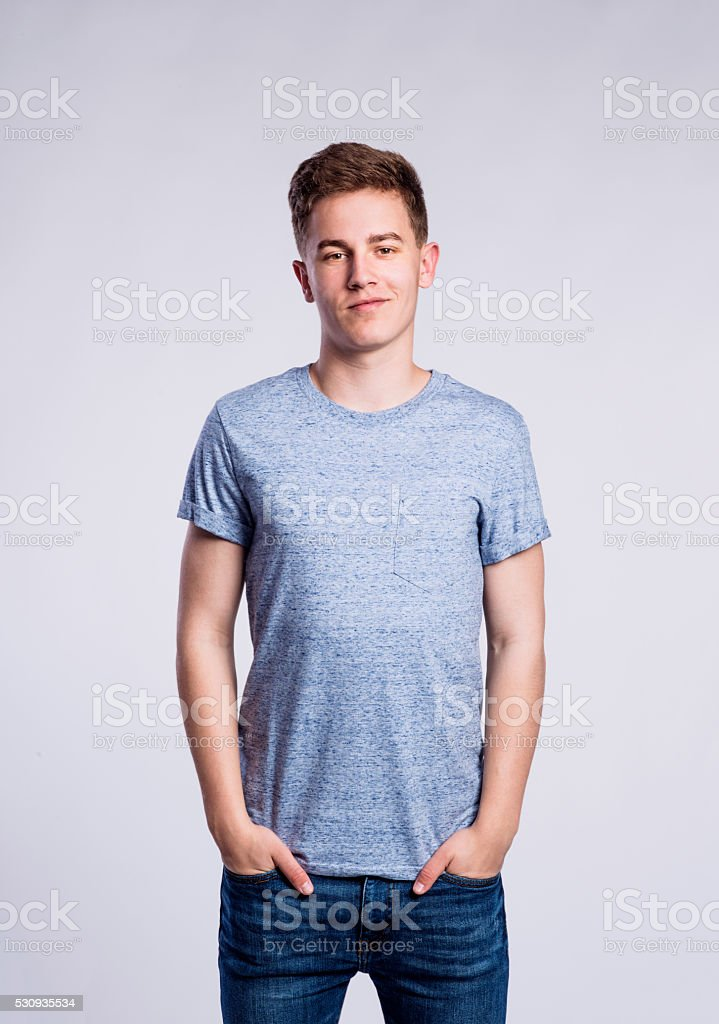 boy in jeans and tshirt young man studio shot stock photo