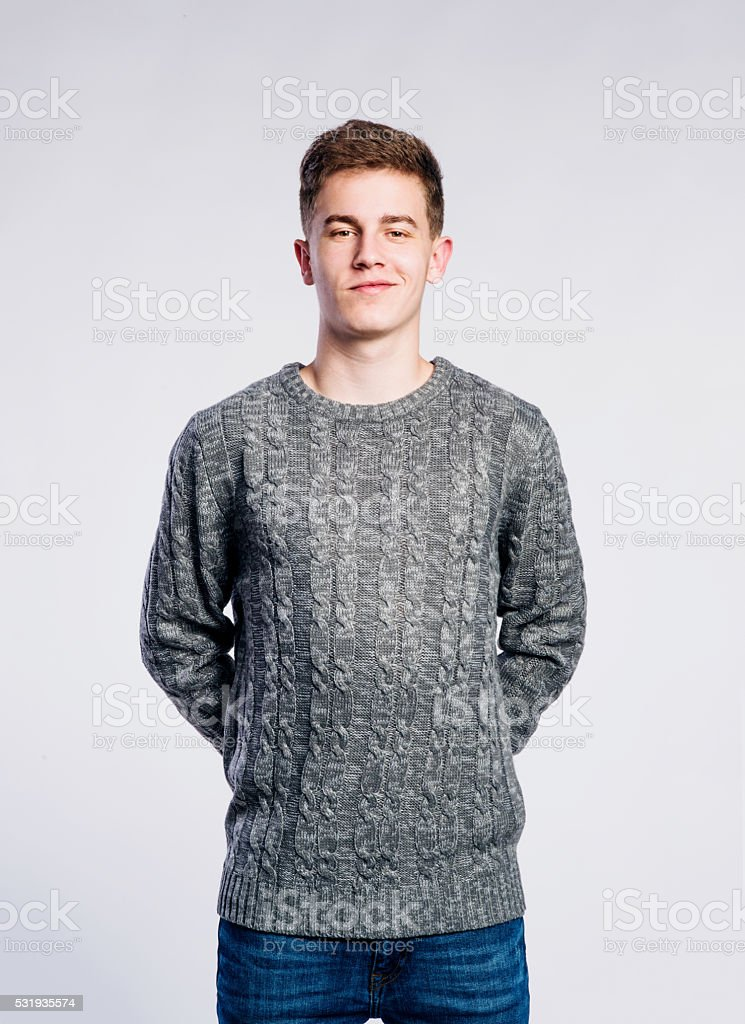 Boy in jeans and t-shirt, young man, studio shot stock photo
