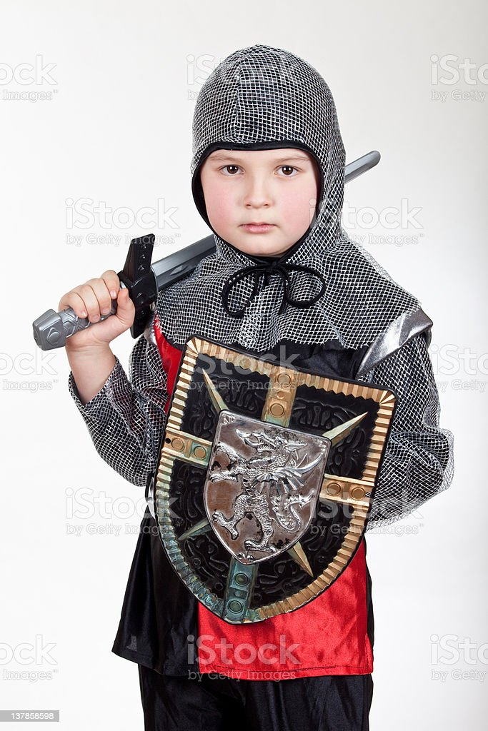 Boy in knight wear look at you stock photo
