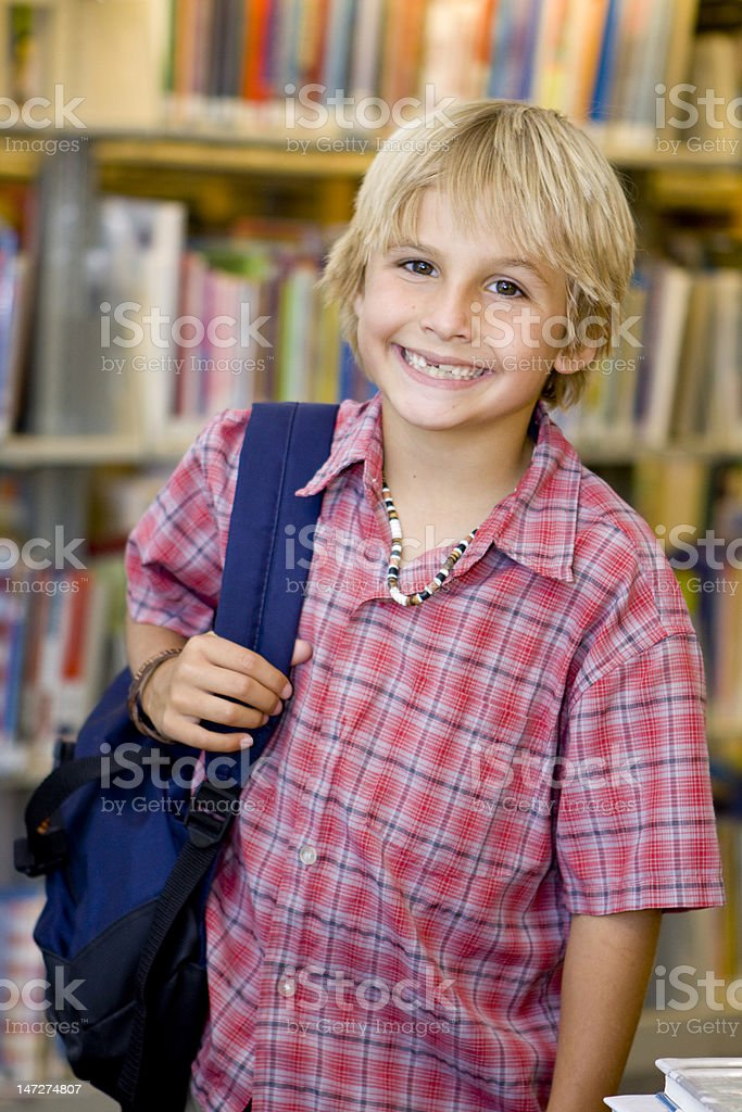 Boy in Library royalty-free stock photo