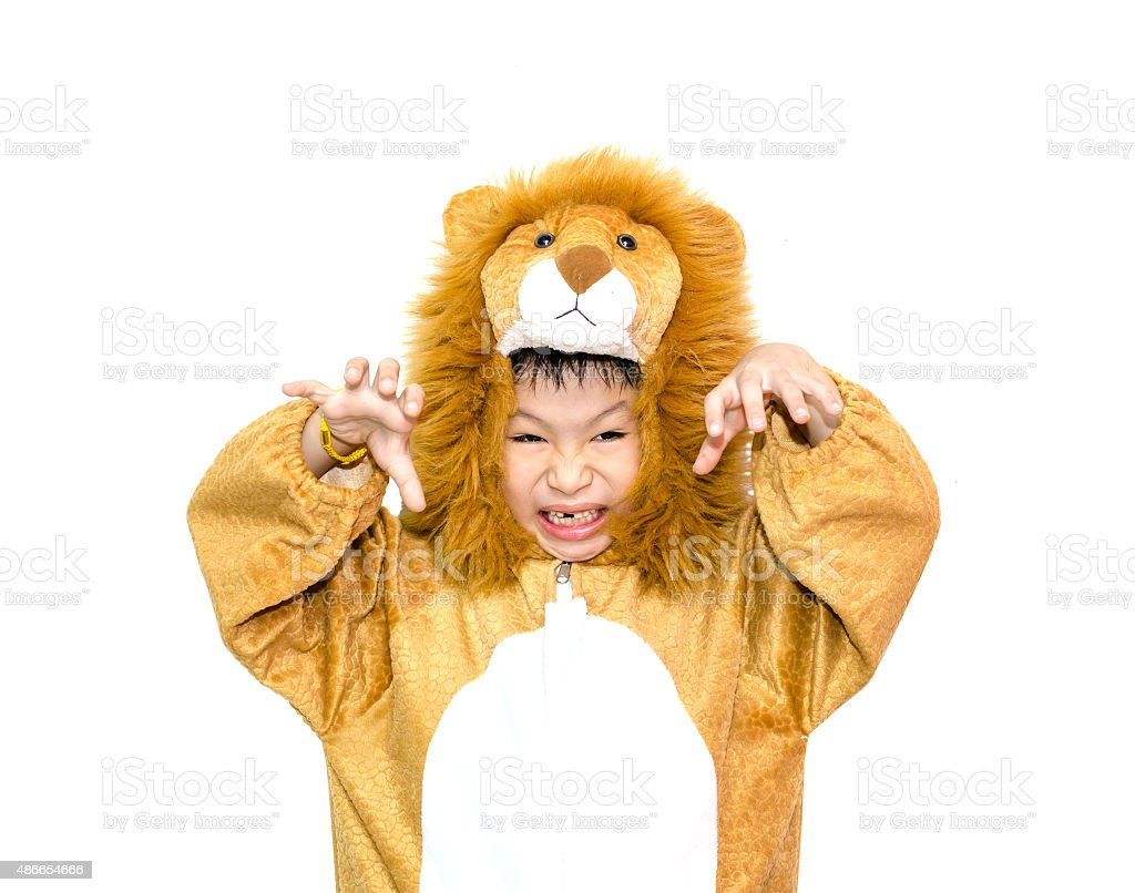 boy in lion costume stock photo
