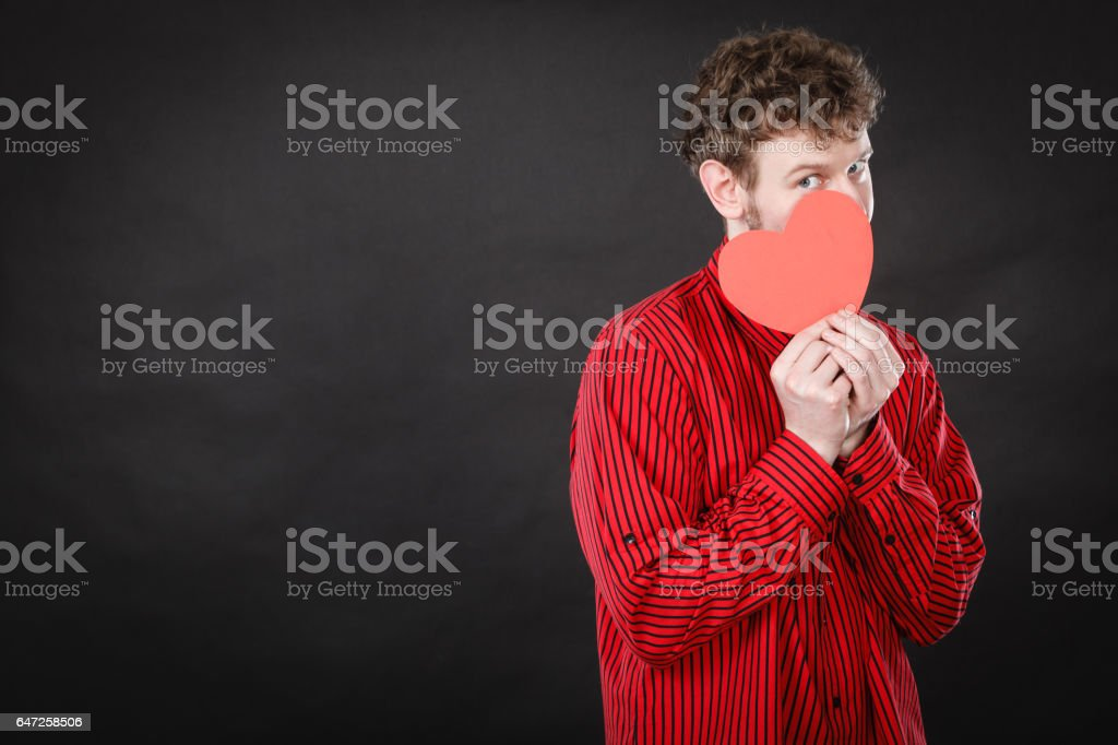 Boy in love with red heart. stock photo