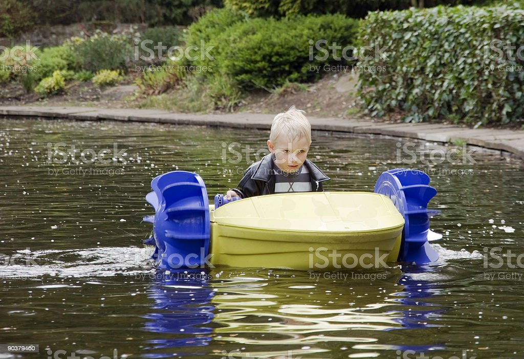 boy in paddle boat royalty-free stock photo