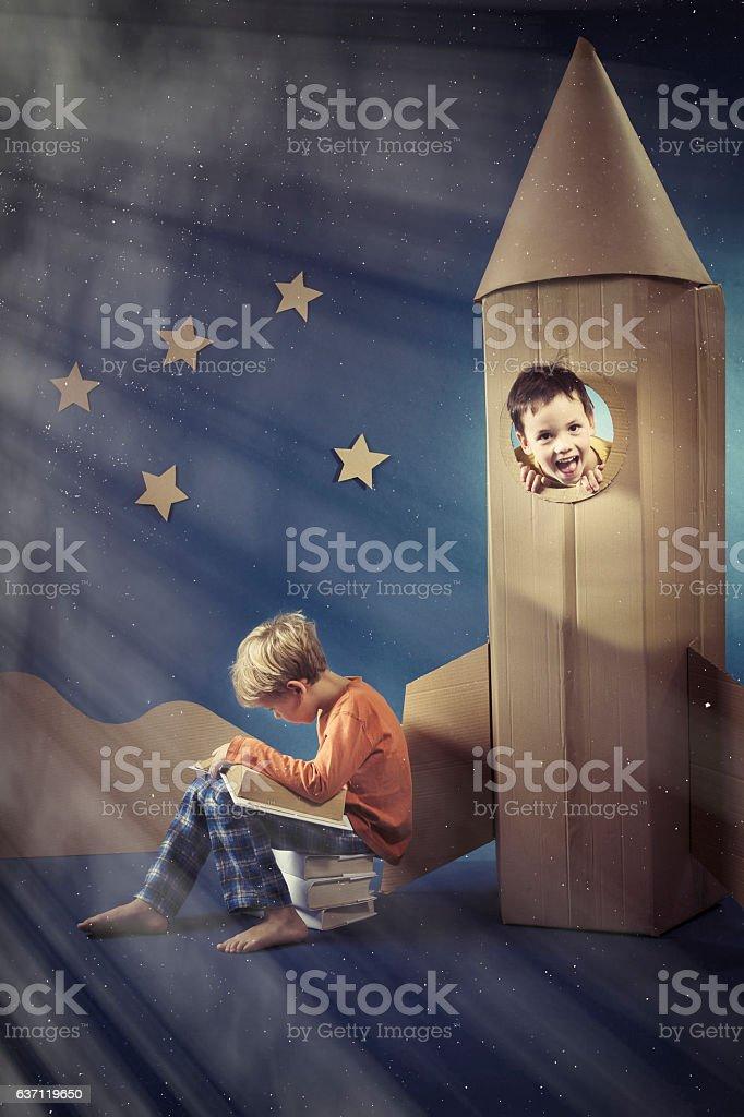 Boy in paper rocket stock photo