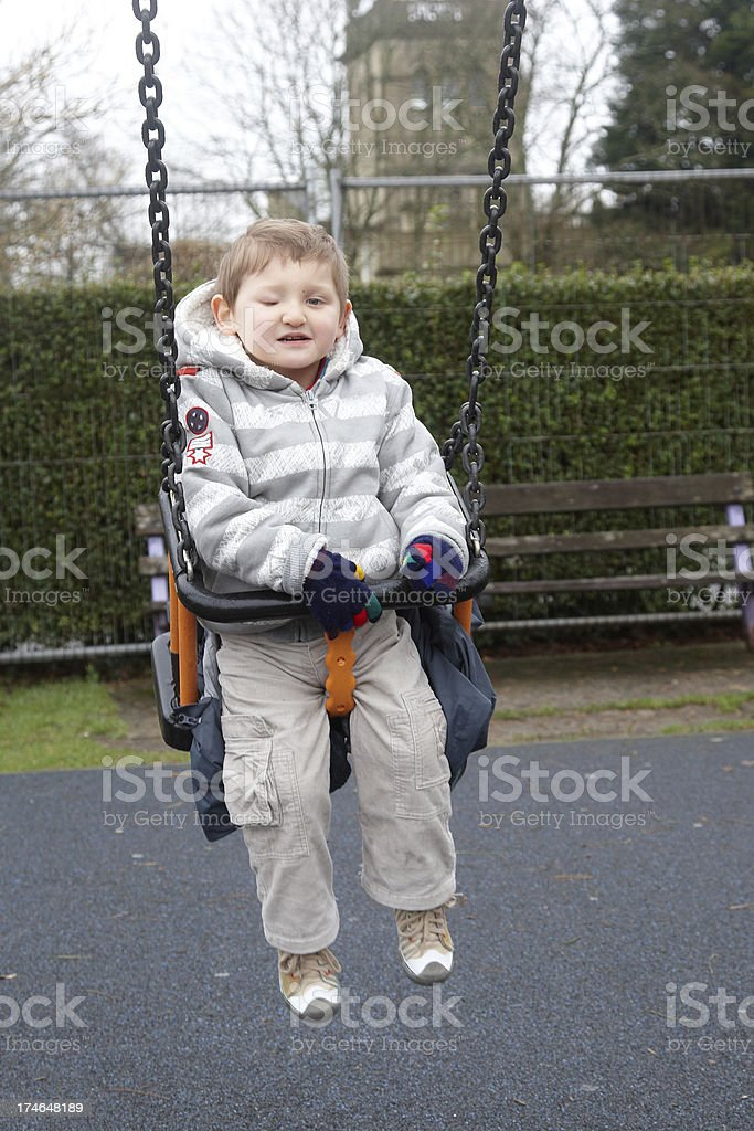 Boy in park swing royalty-free stock photo