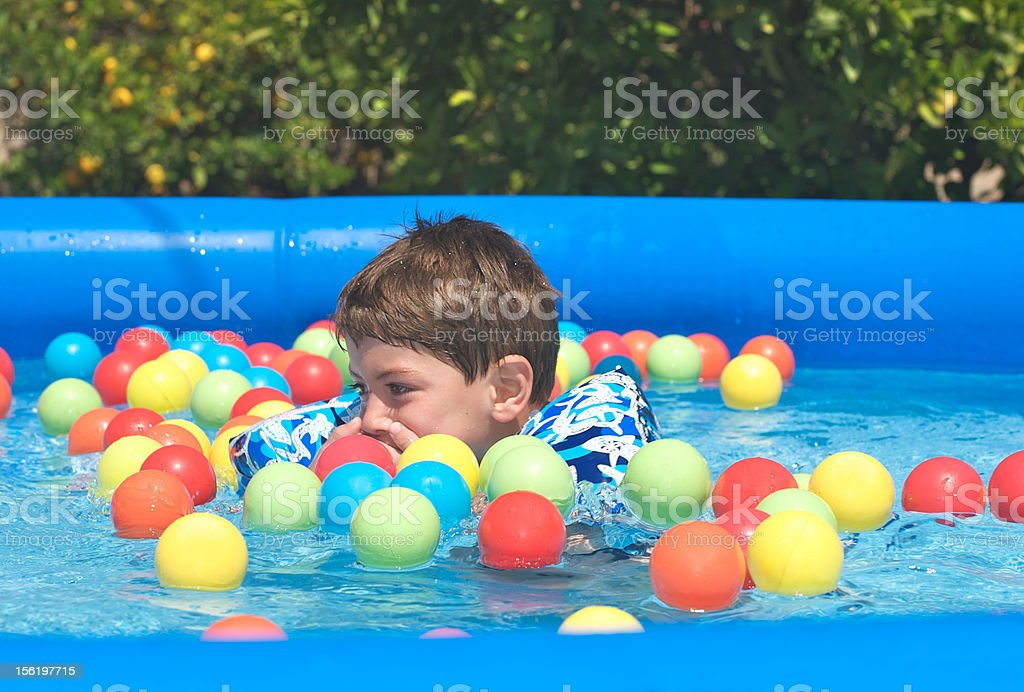 Boy in pool royalty-free stock photo