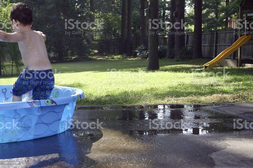Boy In Pool_Horizontal royalty-free stock photo