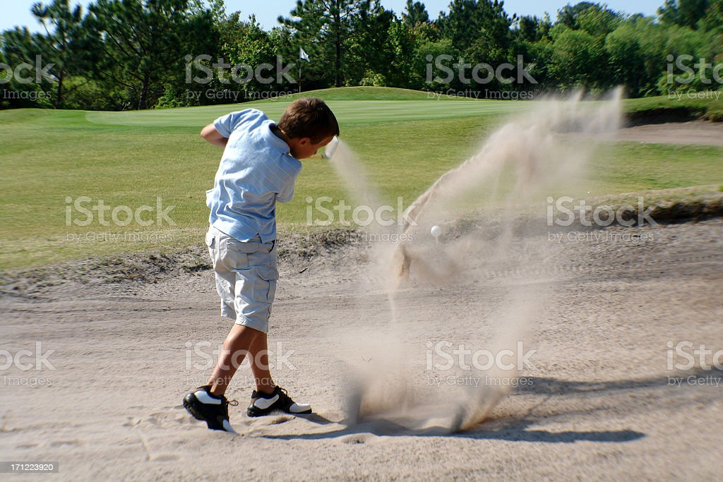Boy in sand trap royalty-free stock photo