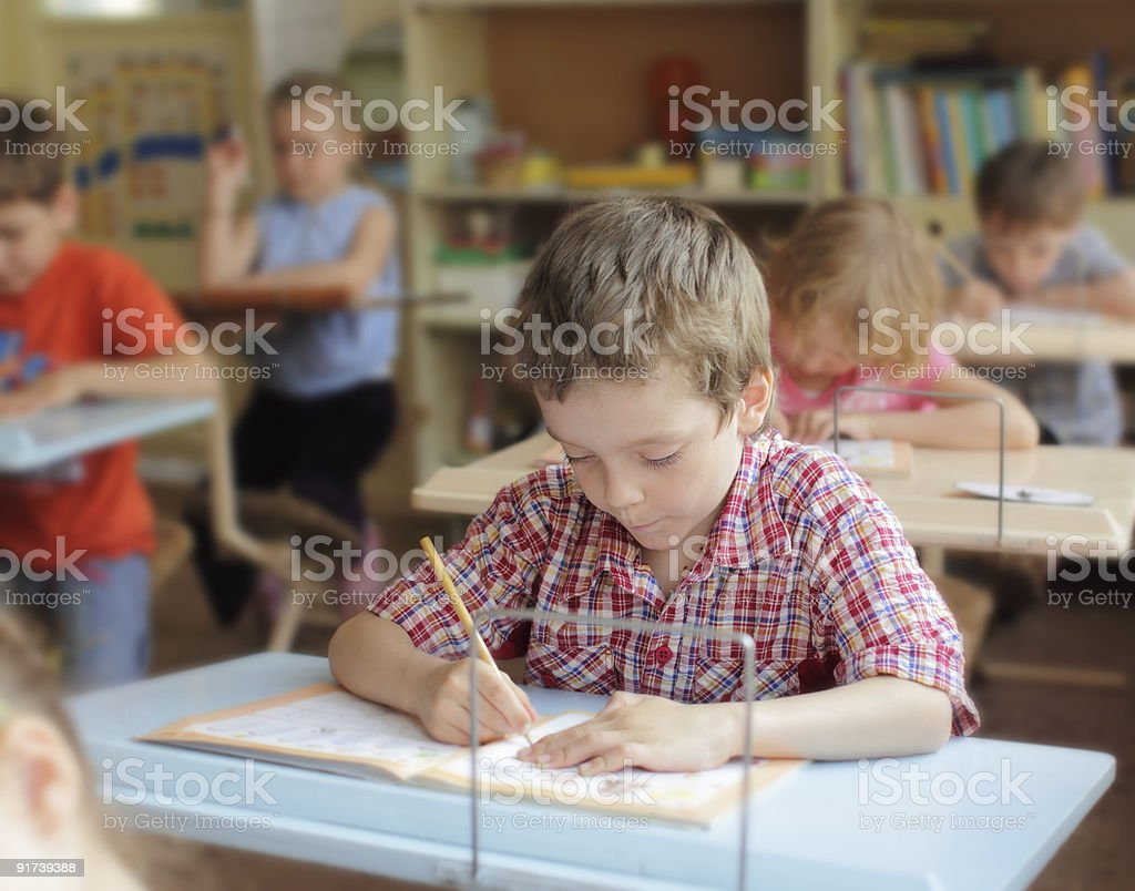 Boy in school class royalty-free stock photo