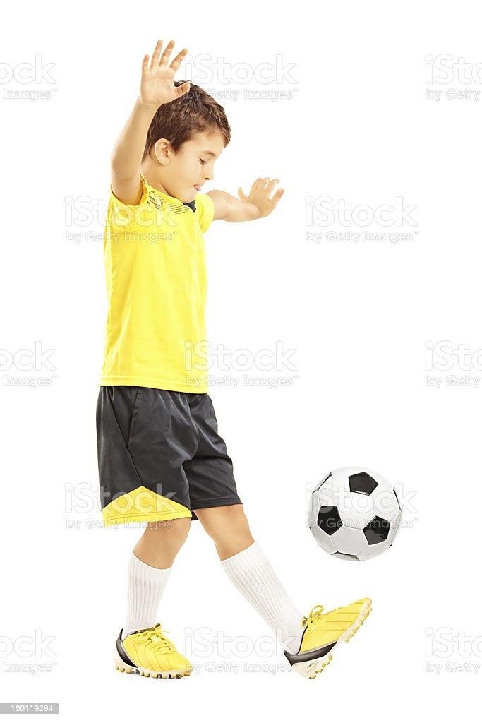 Boy in sportswear joggling a soccer ball stock photo