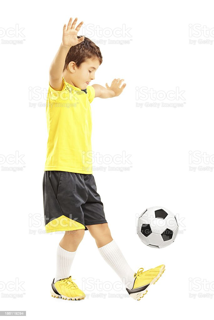 Boy in sportswear joggling a soccer ball stock photo