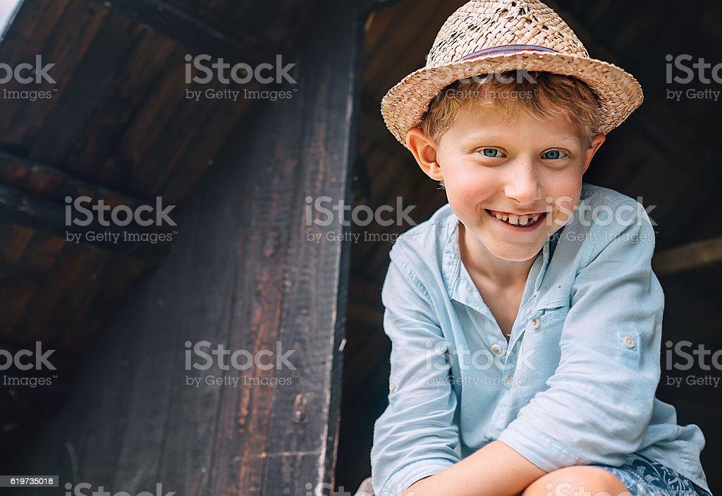 Boy in sraw hat portrait stock photo