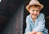 Boy in sraw hat portrait