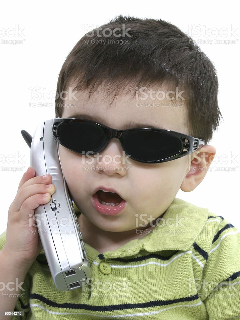 Boy In Sunglasses Speaking On The Phone Over White royalty-free stock photo