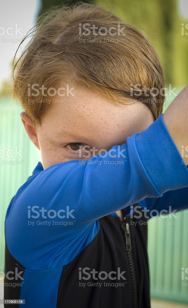 Boy in Swimsuit Peeking & Hiding, Shy Redhead Freckle Face Child royalty-free stock photo