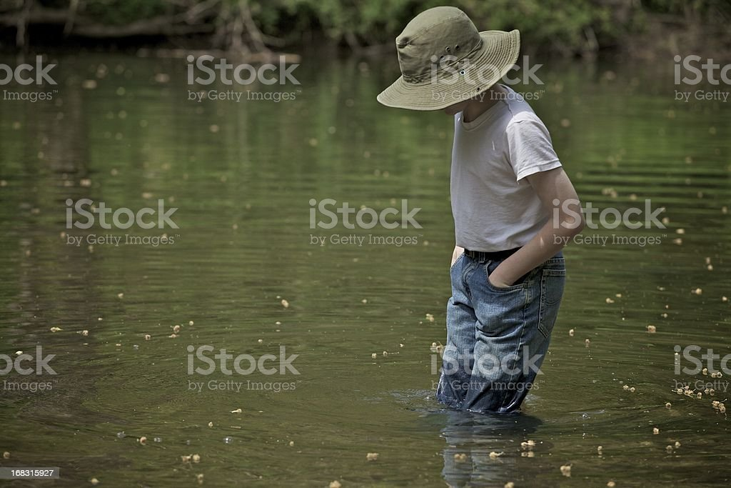 Boy in the creek 2 royalty-free stock photo