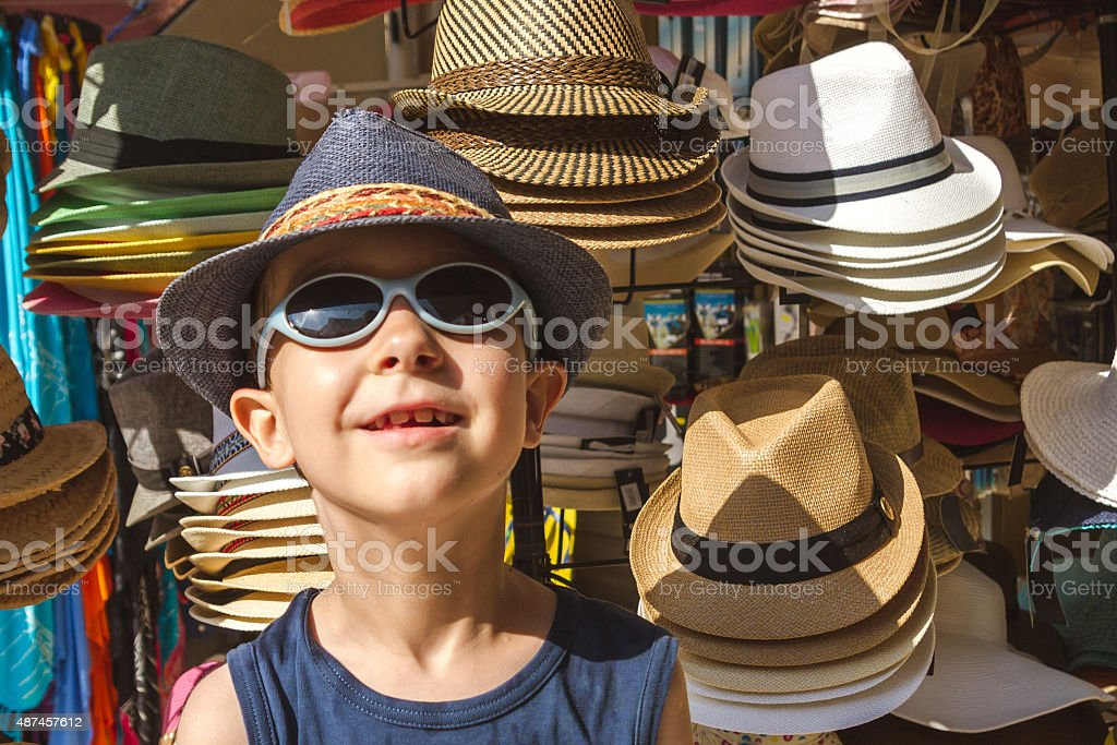 Boy in the Hat Shop stock photo