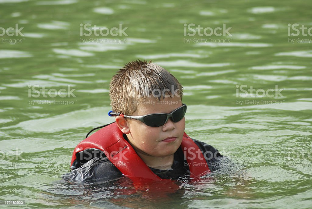 Boy in the Lake stock photo
