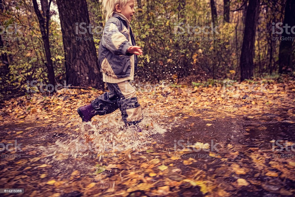 Boy in the park in autumn day stock photo
