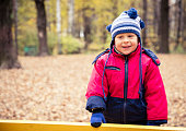 Boy in the park in autumn day