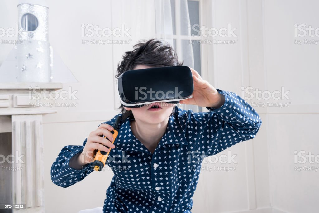 Boy in virtual reality headset stock photo