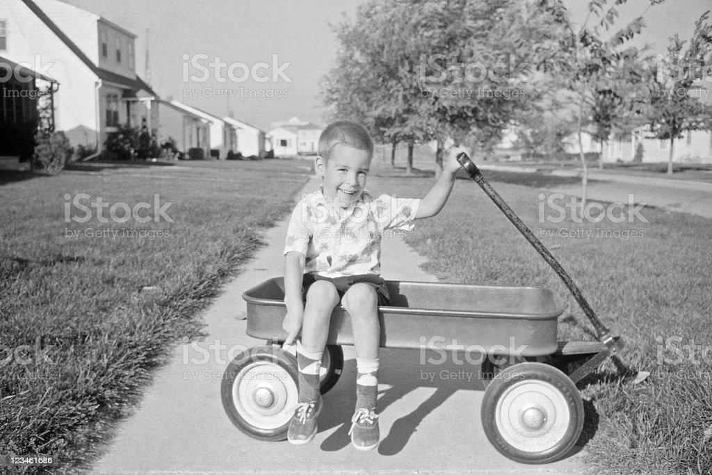 boy in wagon 1957, retro stock photo