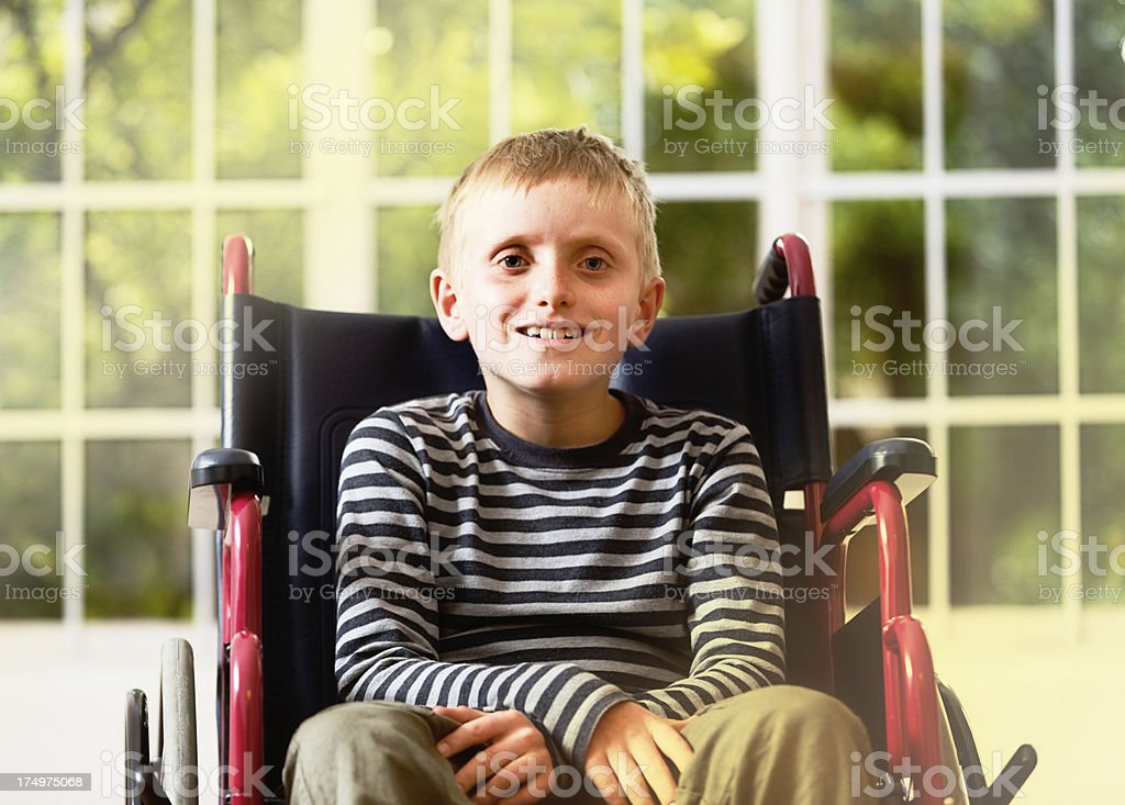 Boy in wheelchair gets good news: perhaps recovery is possible? stock photo