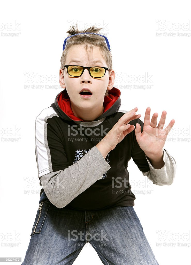 boy in yellow glasses plays the fool stock photo