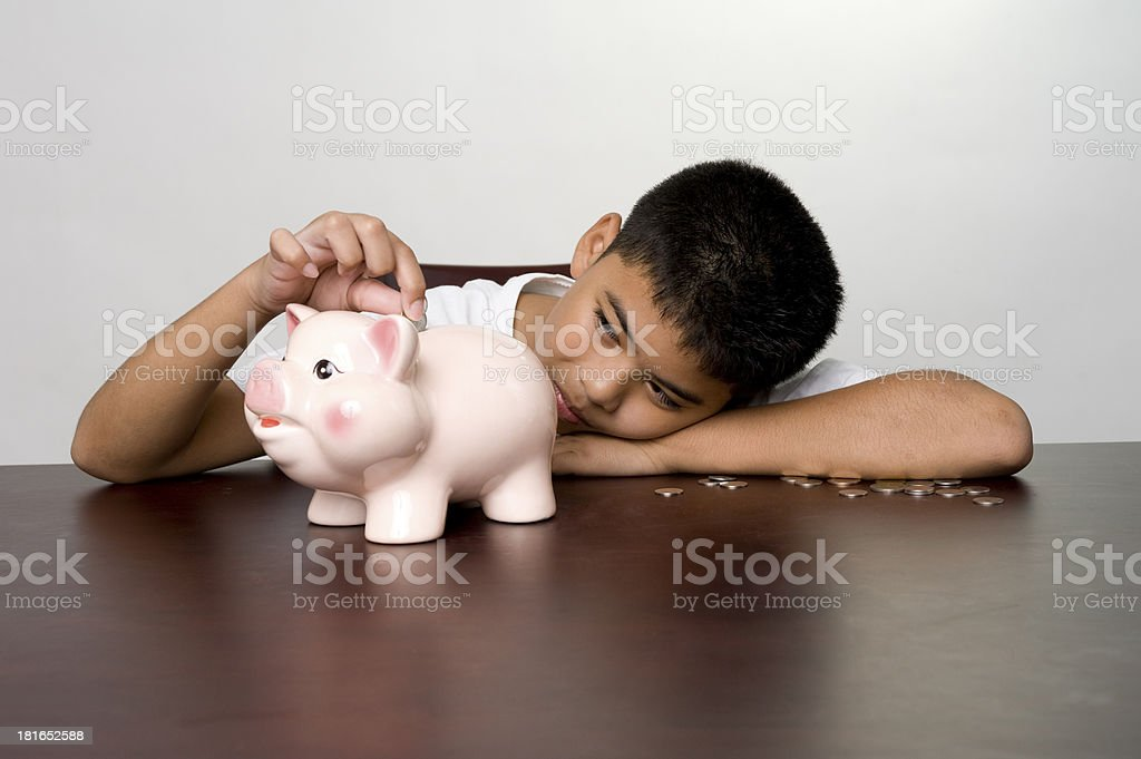 Boy inserting a coin royalty-free stock photo