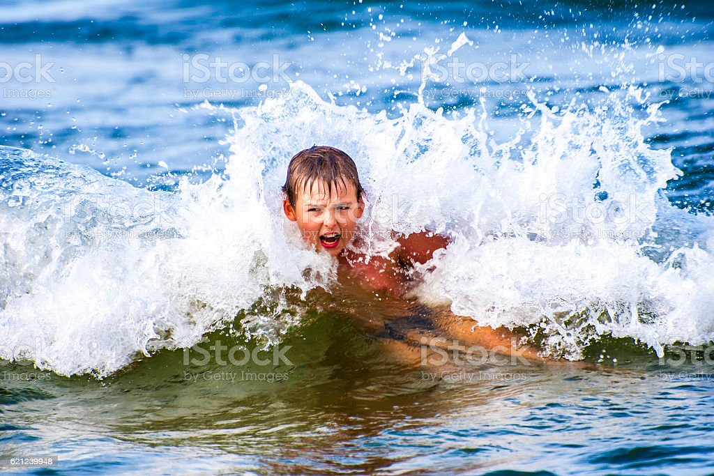 Boy Inside Wave stock photo