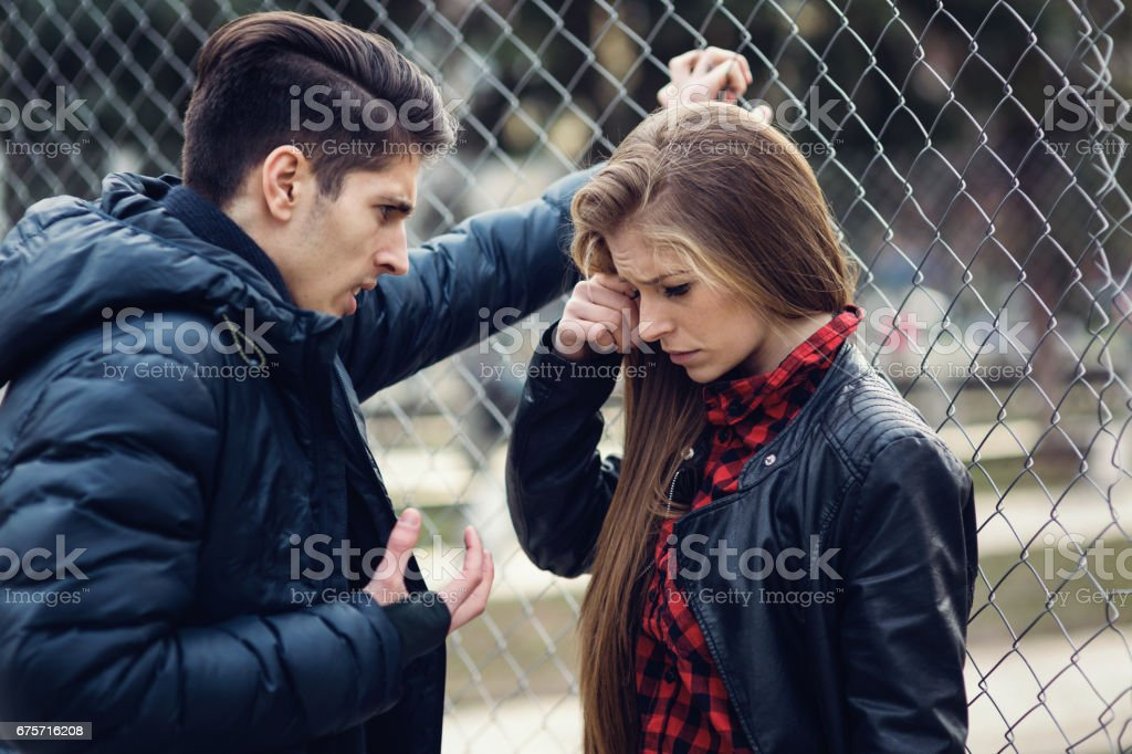 Boy insulting his girlfriend stock photo