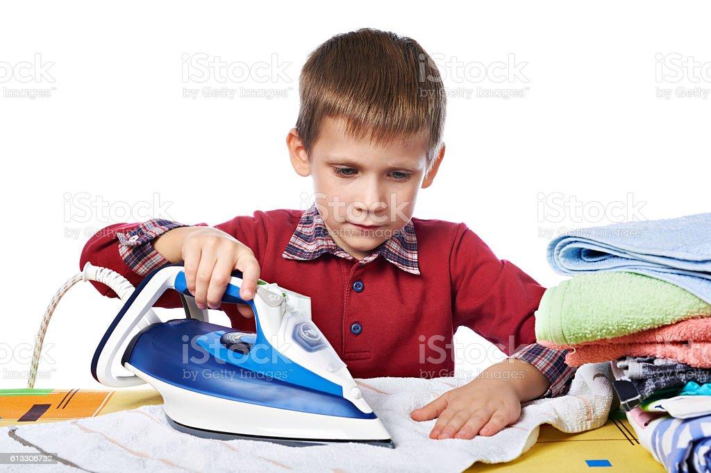 Boy ironed washed linen isolated stock photo
