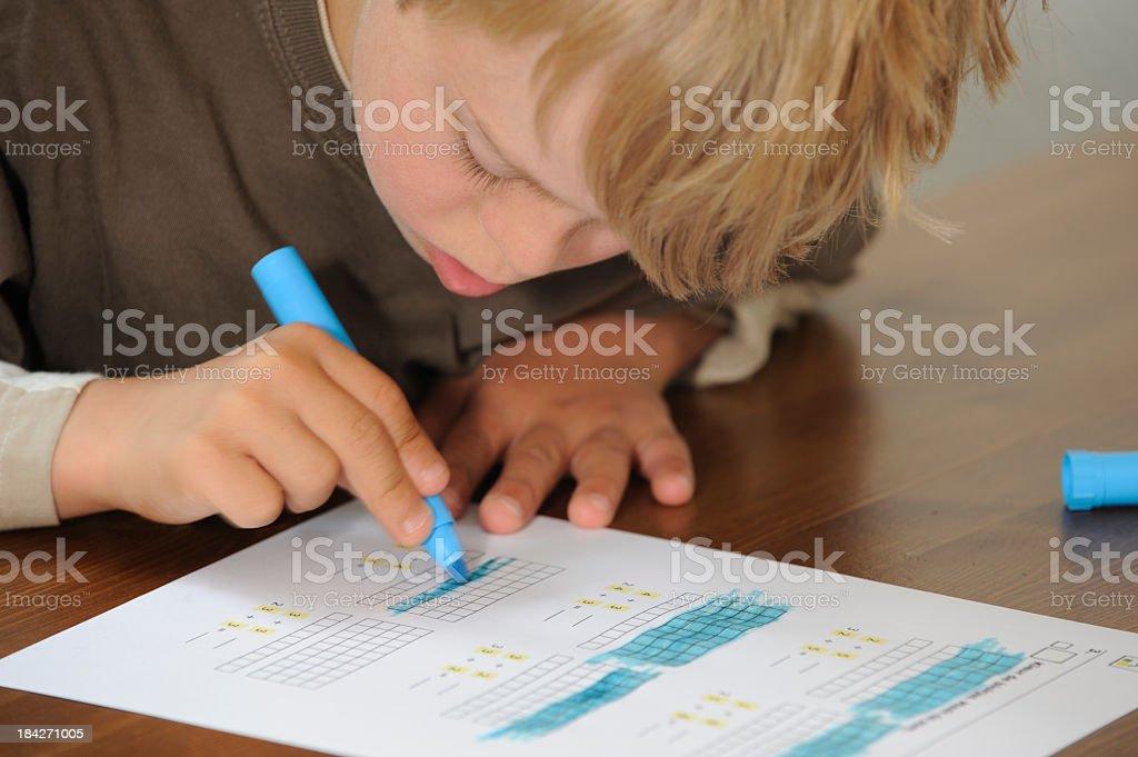 Boy is doing his mathematics. royalty-free stock photo