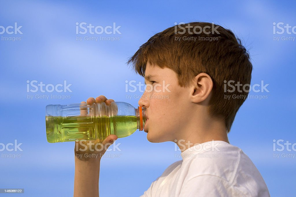 Boy is drinking royalty-free stock photo