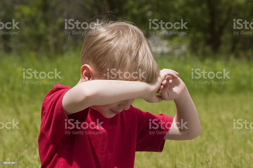 Boy is hidden from a sunlight. royalty-free stock photo
