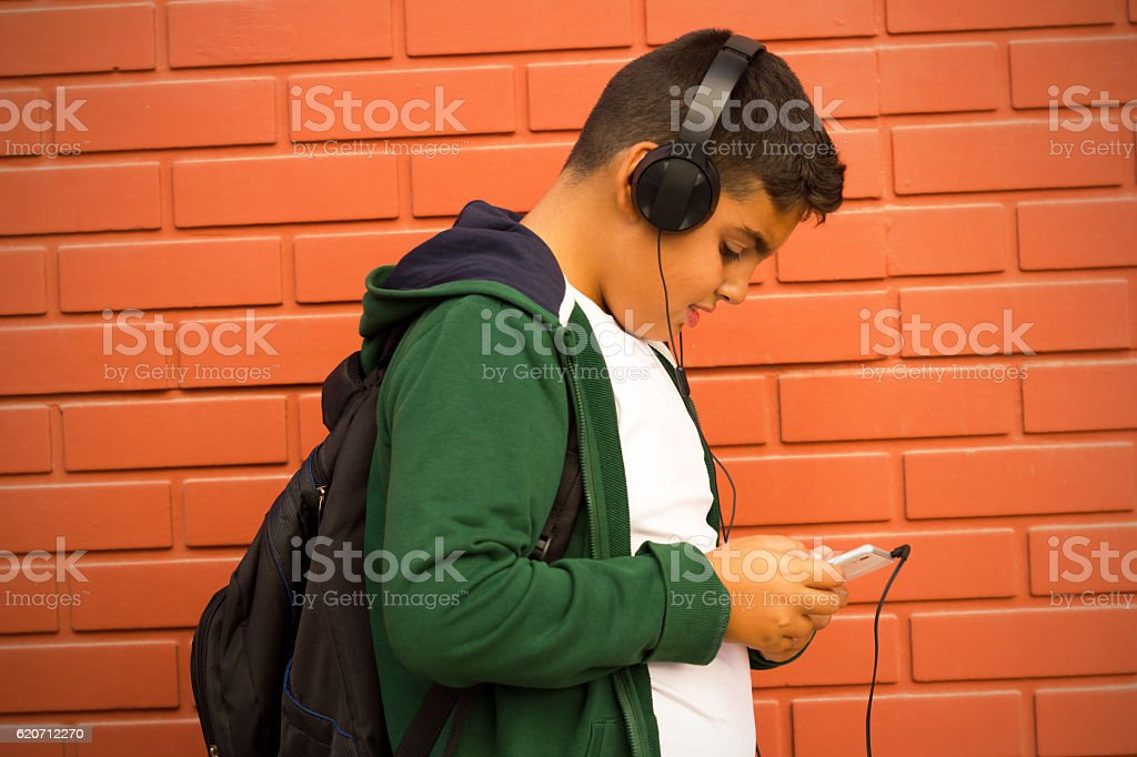 Boy Is Listening Music With Smartphone stock photo
