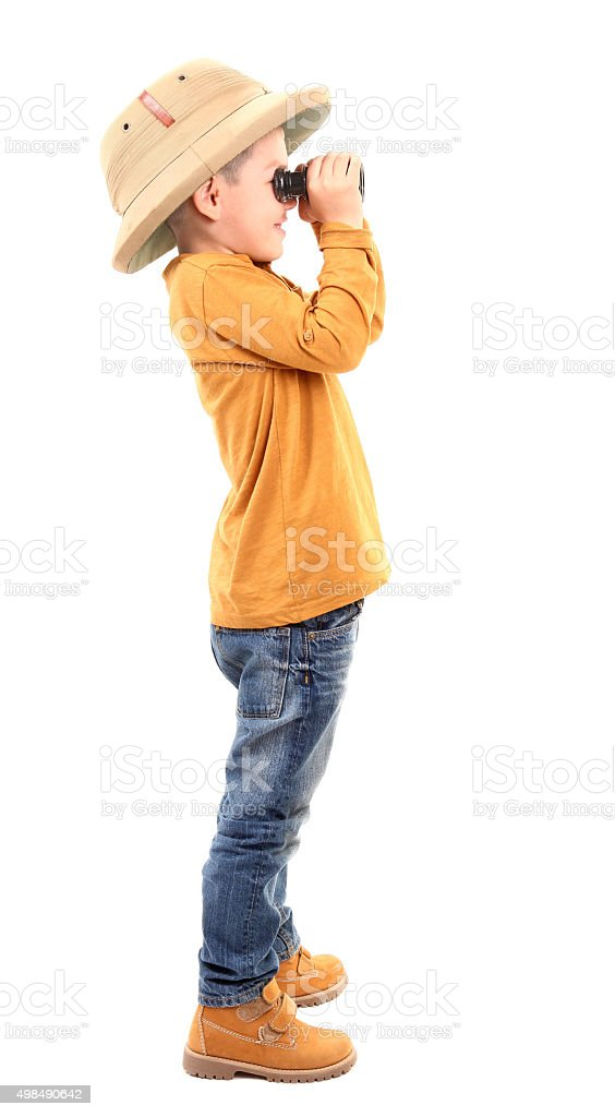 Boy is looking through binoculars stock photo