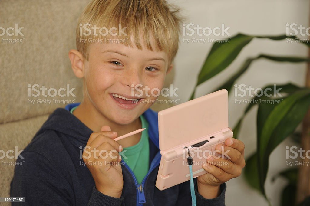 Boy is playing on mini computer royalty-free stock photo