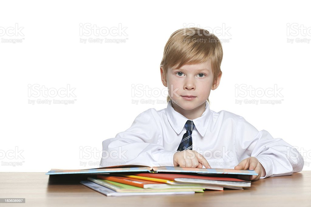 Boy is reading at the desk royalty-free stock photo