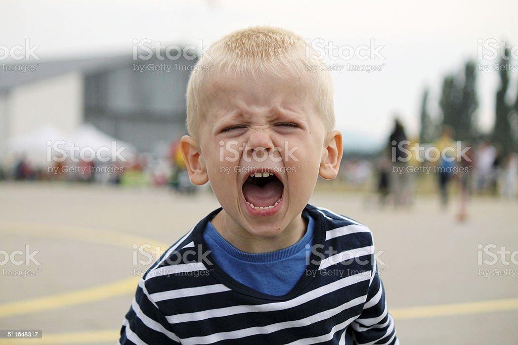 Boy is shouting stock photo