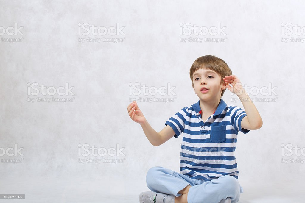 Boy is speaking to himself stock photo