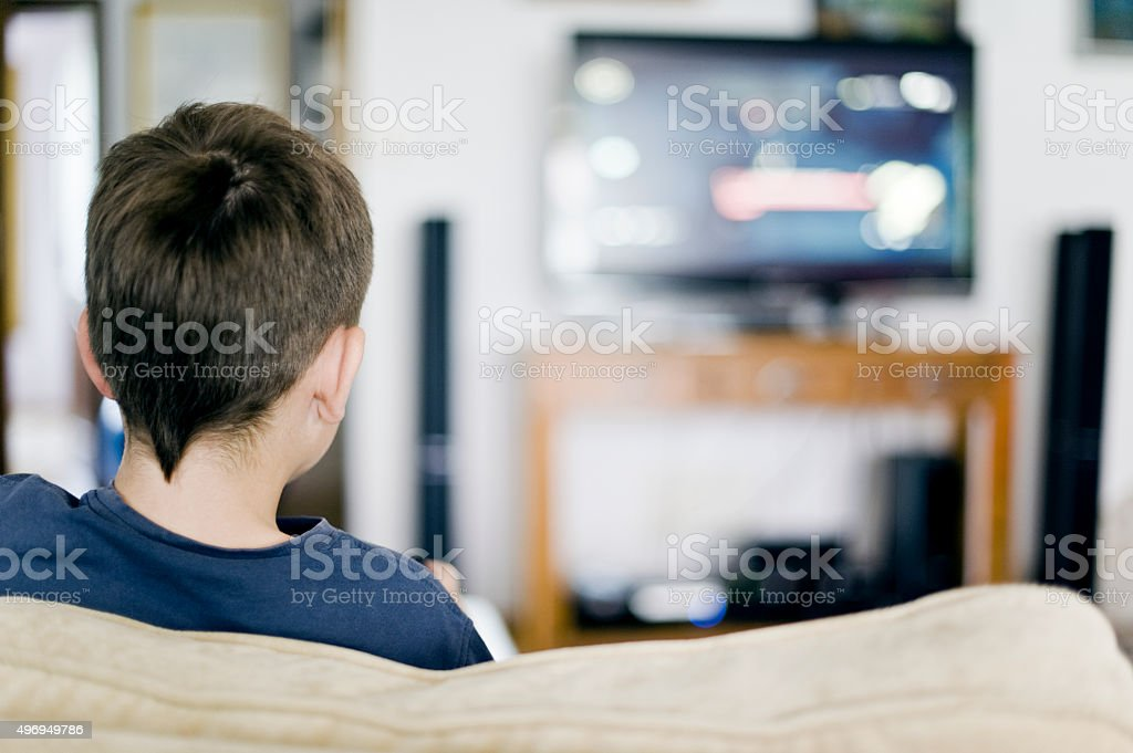 Boy is watching TV stock photo