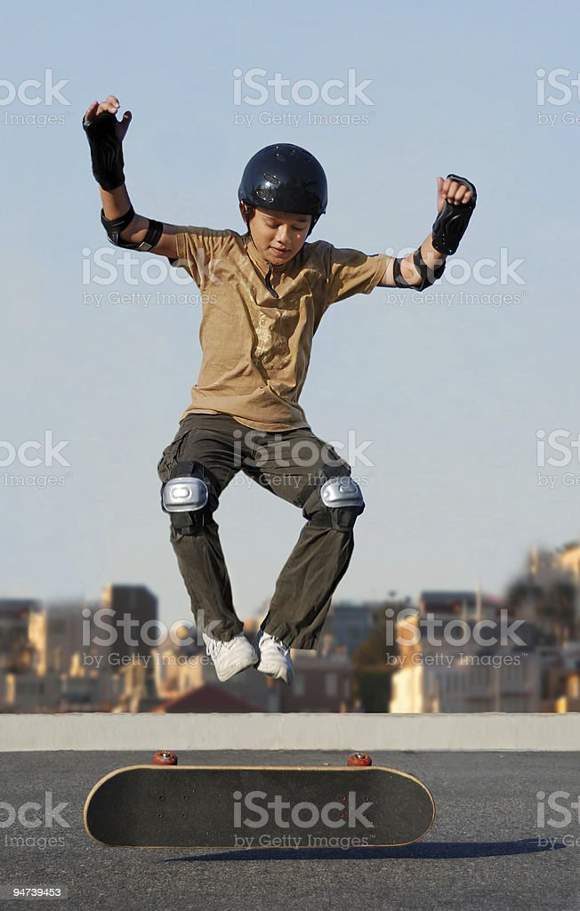 Boy Jumping from Skateboard royalty-free stock photo