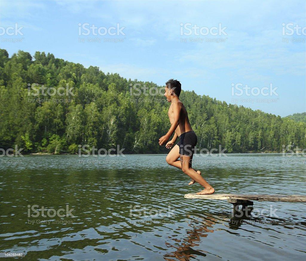 boy jumping in lake royalty-free stock photo